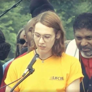 Cortne Lee Roche speaking out in DC at the Poor Peoples Campaign for UFCW, June 23, 2018. Poor Peoples Campaign leader, Rev. William Barber to her left.Liberation photo.