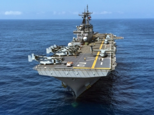"""""""The USS Essex, which holds 2,000 soldiers, is one of many warships in the Persian Gulf."""" Source: US Navy, public domain image.. (U.S. Navy photo by Mass Communication Specialist 3rd Class Huey D. Younger Jr./Released)"""