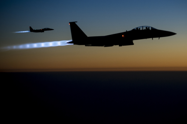 A U.S. aircraft returns from an illegal bombing mission over Syria in 2014. (DoD photo by Senior Airman Matthew Bruch, U.S. Air Force/Released)