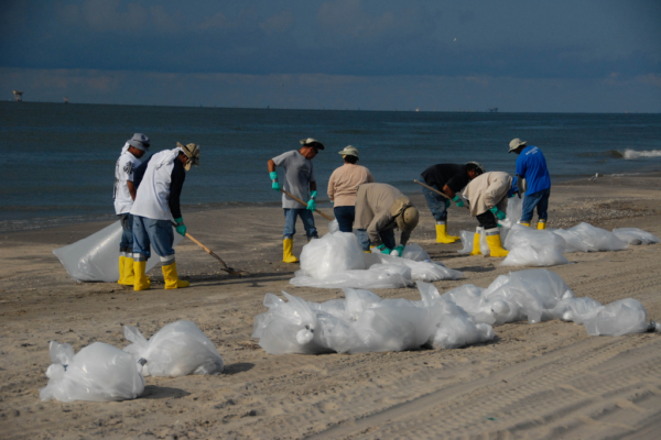 Beach cleanup during Deep Horizon event. Public domain image: National Institute for Occupational Safety and Health.
