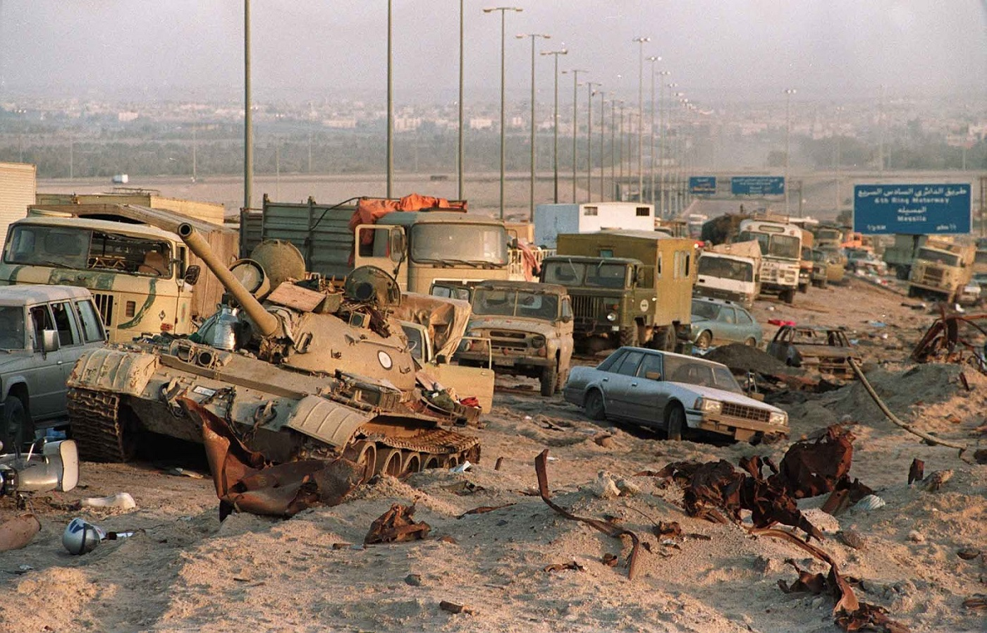 "Photo of George H.W. Bush's complicity in the 1991 ""Highway of Death"" massacre"