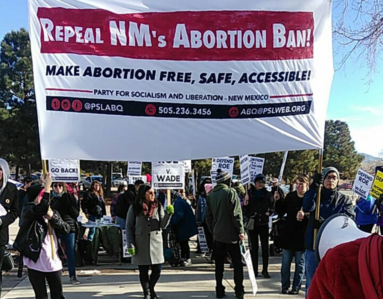 Photo of Banner drop caps week of protest against NM abortion ban