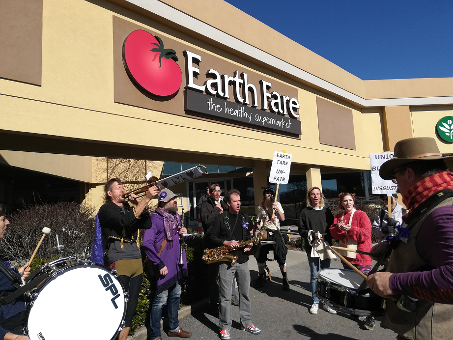 Dozens rally in solidarity with Earth Fare union