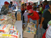 Volunteers pack food at a CLAP food distribution center for the elderly and disabled who need delivery to their homes. Antímano neighborhood on the outskirts of Caracas, Feb. 16, 2019. Gloria La Riva, Liberation photo