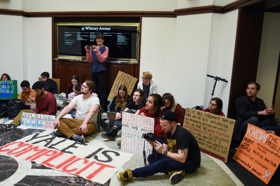 Photo of Yale students sit in for fossil fuel divestment & justice for Puerto Rico