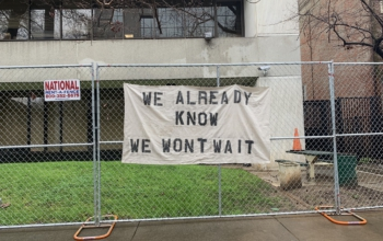 Sacramento DA's office with banner hung by protesters, March 2. Liberation photo.