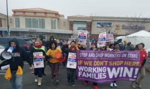 Workers and supporters march and rally at the South Bay Stop & Shop in Dorchester. Liberation Photo.