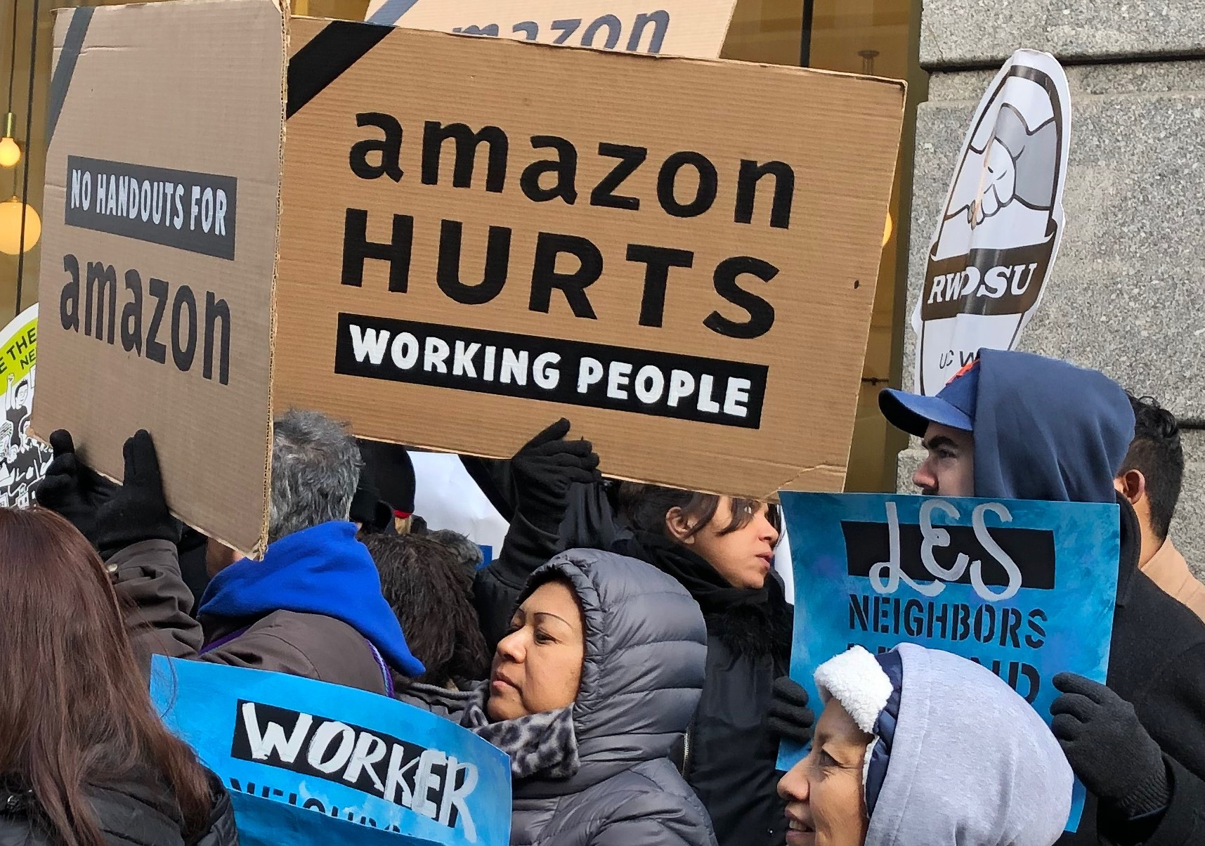 Photo of Workers to Amazon: 'We are not robots!'