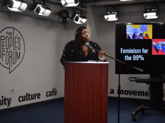 Kerbie Joseph speaking at the Feminism for the 99% conference