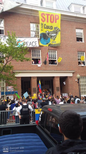 Photo of Venezuela embassy protectors stand strong against coup supporters' attacks