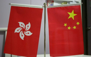 Flags of China and the Special Administrative Region of Hong Kong. Photo: Ernie Chan