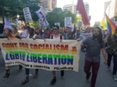 Members of the Party for Socialism and Liberation march in the Boston Pride Parade 2019 holding a banner that reads