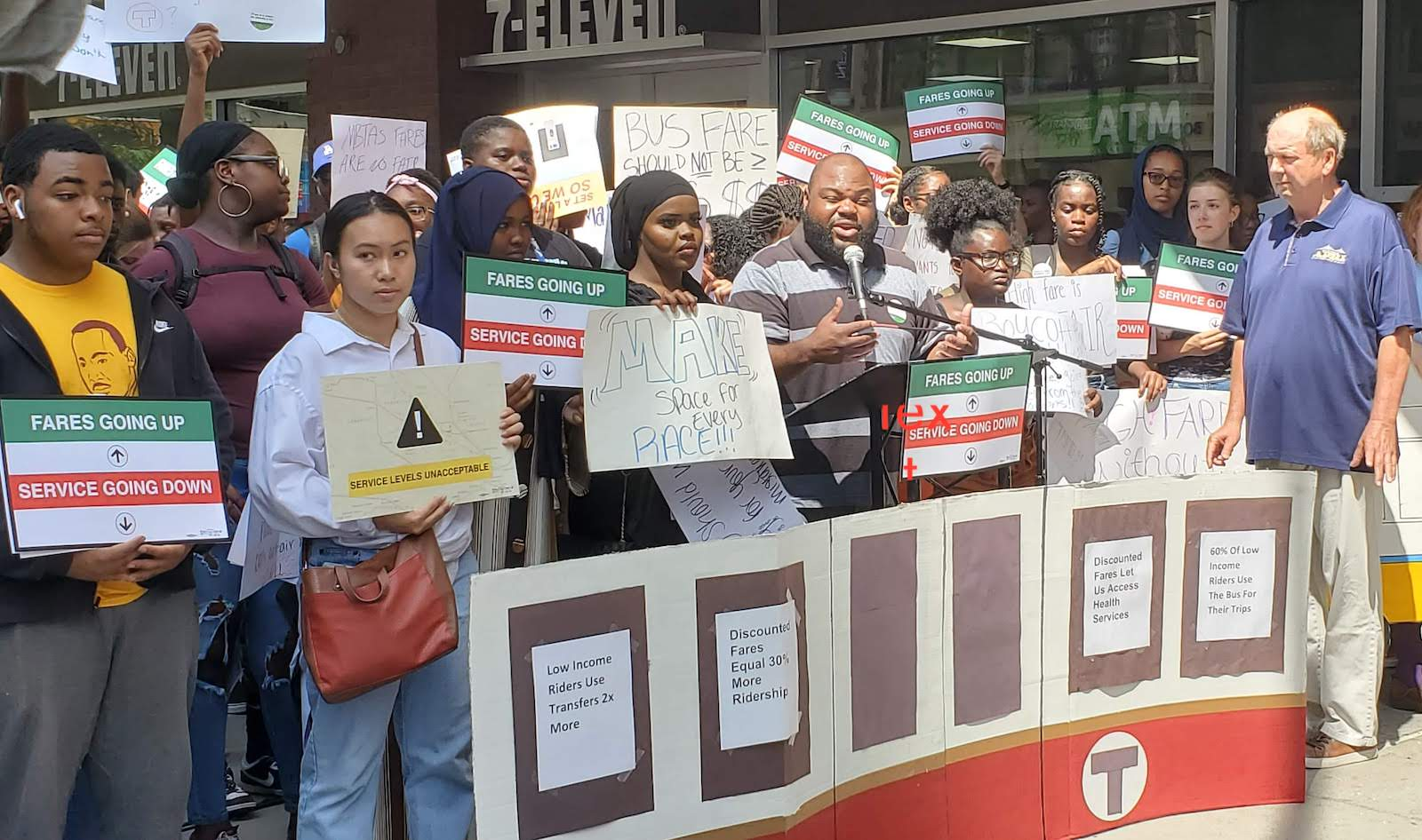 "Photo of Boston residents demand ""fair fares"" from the MBTA"