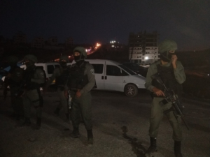 IDF Soliders wait with guns in the middle of the night