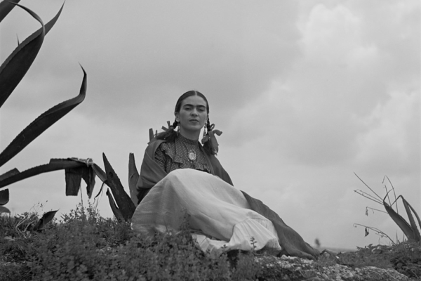 Frida Kahlo, seated next to an agave plant, from a 1937 photo shoot for Vogue entitled