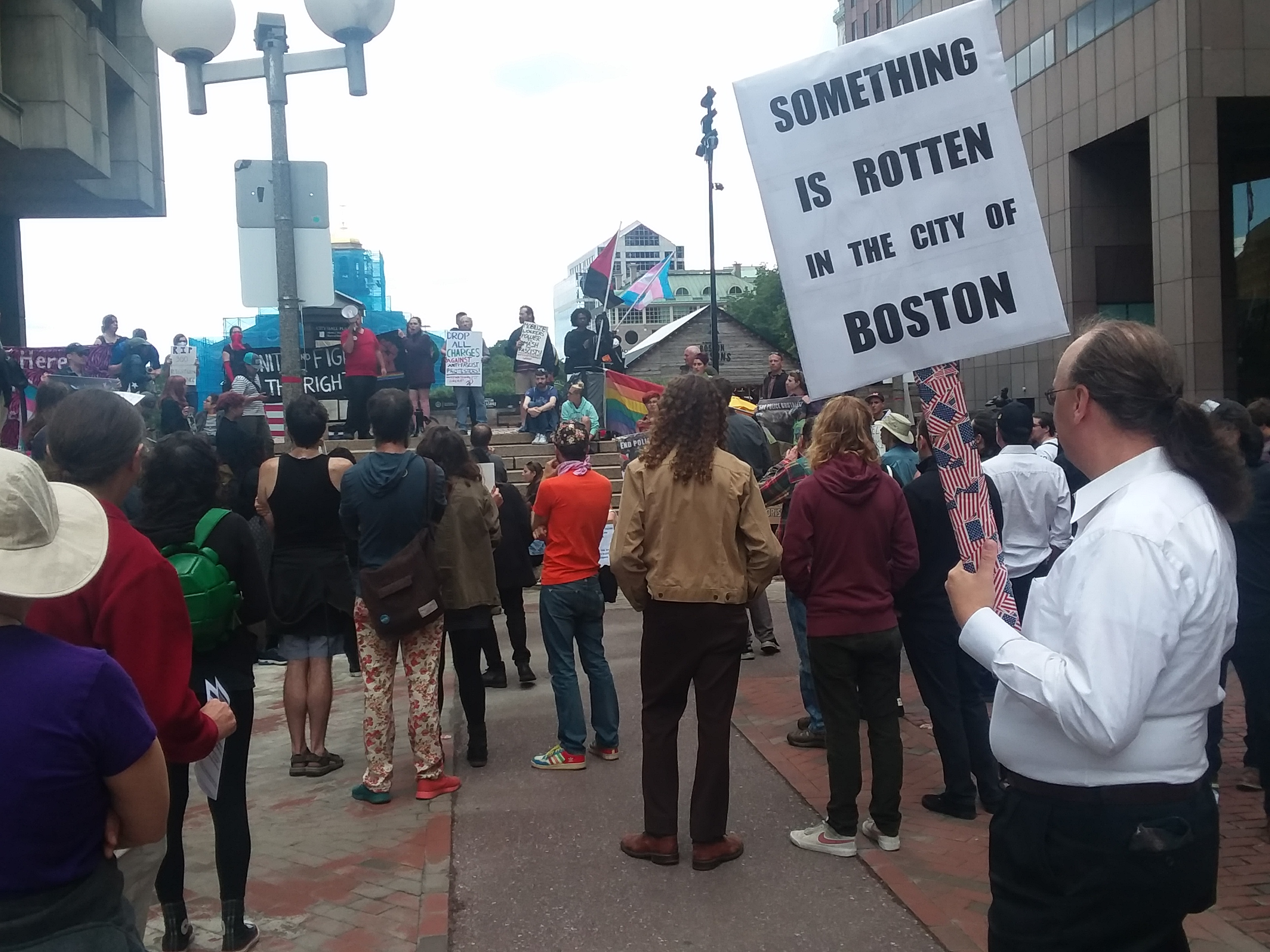 """""""something is rotten in the city of boston"""" protest sign"""