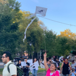 Connecticut activists march around New Haven Green with kites