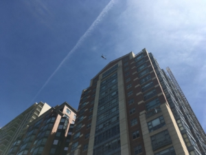 Police helicopters watch over downtown Boston.