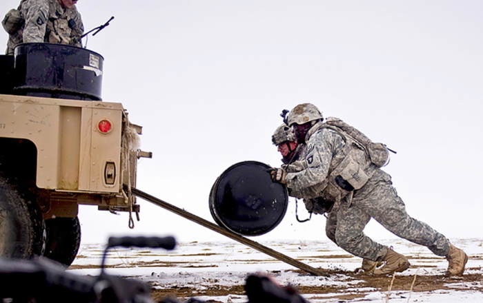 Soldiers recovering bundles of fuel for Forward Operating Base Waza K'wah in Afghanistan. (U.S. Air Force Photo/ Master Sgt. Adrian Cadiz)
