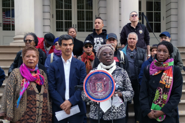 NYC Council members, flanked by activists, introduce bill on steps of City Hall. Photo: Kei Pritsker