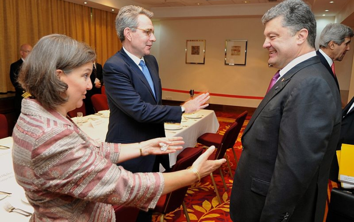 Assistant Secretary of State Victoria Nuland and U.S. Ambassador Geoffrey Pyatt with Ukrainian President Petro Poroshenko, who they brought to power in the 2014 coup. Then-Secretary of State John Kerry stands in the background. Photo: U.S. Department of State, June 4, 2014