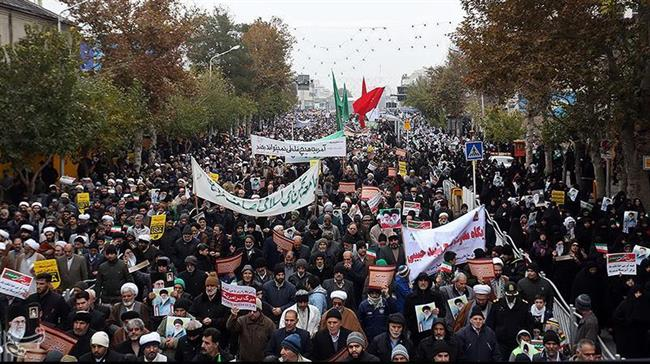People march in support of the Islamic Republic and against the campaign of sabotage, Nov. 22, in the Northeastern city of Mashhad. Photo: Hamshahri