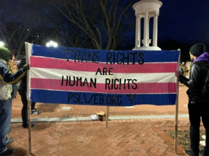 "Members of the PSL hold a banner the color of the trans flag that reads ""Trans Rights Are Human RIghts"" outside on the New Haven Green."