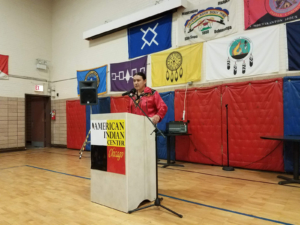Chase Iron Eyes gives a talk for the reception opening. Photo by Liberation News.