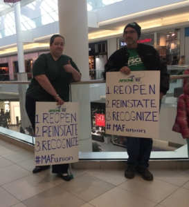 Peaceful protesters outside GUESS in the CambrdigeSide Galleria, Cambridge, Massachusetts.