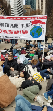 Students lead a die-in by the Bean in Chicago's Millennium Park during the December 6 Climate Strike. Photo by Liberation News.
