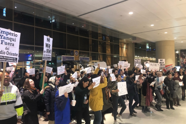 Protesters gather at Boston Logan Airport to demand the release of Shahab Dehghani.