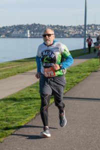 Andy running on Alki Beach in West Seattle, Oct. 2019. Used with permission.