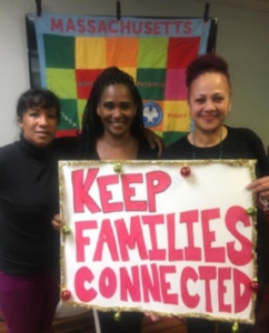 "Leslie Credle and other Families for Justice as Healing members holding a sign that reads ""Keep Families Connected."""