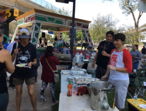 Members of San Diego PSL at a Chicano Park food share in 2018.
