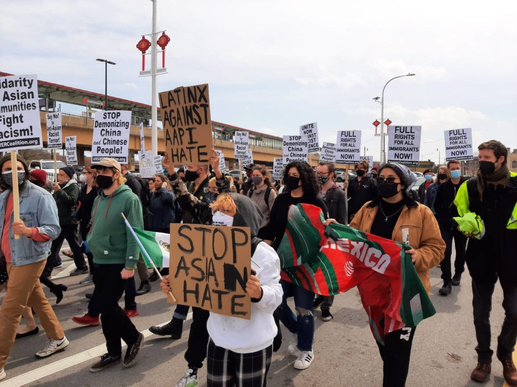 Demonstrators took to the streets in Chicago's Chinatown. Liberation photo
