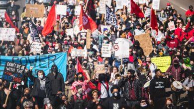 Demonstrators march through Lansing, Michigan, March 20. Photo credit: Marc Klockow