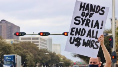 Photo of Houston demonstration demands, 'Fix our broken pipes, no more airstrikes!'