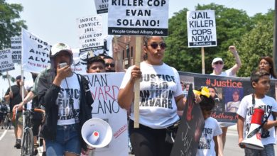 Demonstrators march from the 16th District Police Station to Alderman Gardiner's office demanding the arrest of killer cop Evan Solano. Liberation photo