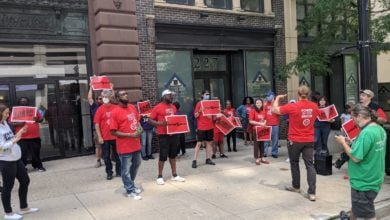 Janitors rally outside the SEIU Local 1 offices in Milwaukee to demand a $15-an-hour minimum wage. Liberation photo