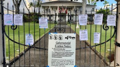 Demonstrators leave symbolic eviction notices outside the Governor's Mansion in Honolulu. Liberation Photo