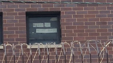 Inmates hold up signs decrying the conditions inside the Cook County Jail. Liberation photo